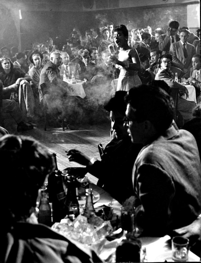Billie Holliday performing at Cafe Society, NYC's first intergrated nightclub, 1947 - photograph by Gjon Mili