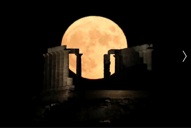 A full moon rises behind the Temple of Poseidon in Cape Sounion, near Athens, Greece,.png